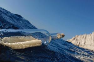 1-bottle-containing-message-floating-in-sea-sami-sarkis